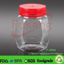 300ml Clear PET Plastic Honey Jars And Unique Shape Plastic Sweet Bottle Container With Red Screw